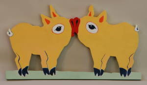 painting of two pigs kissing